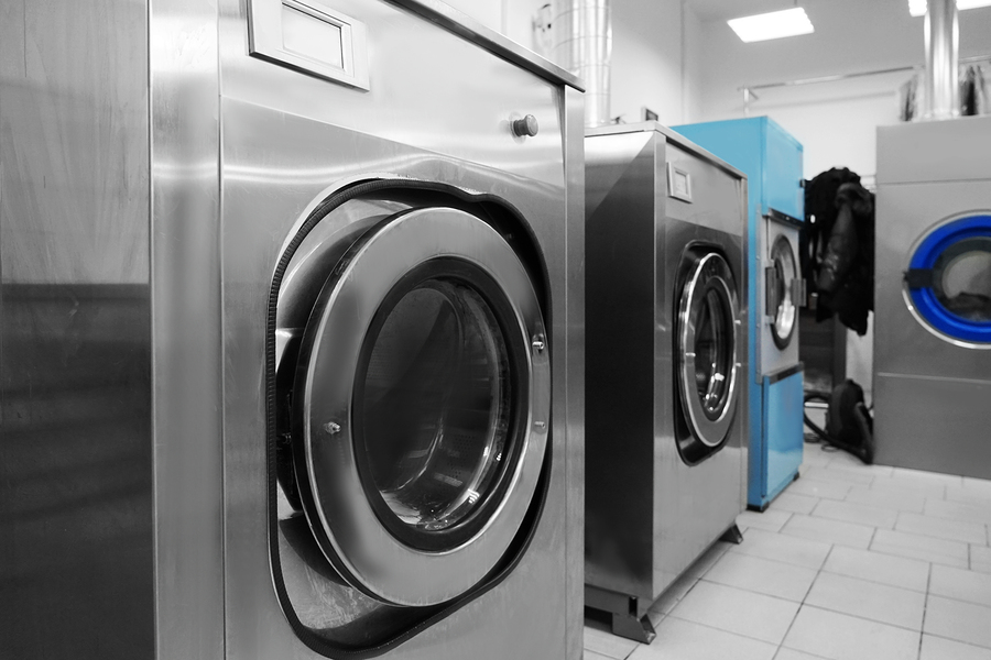 Industrial laundry washing machines in dry cleaner's workshop, PERC